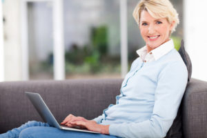 Smiling older lady with a laptop
